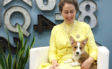 Melissa dressed as the Queen for Halloween, Corgi on her lap