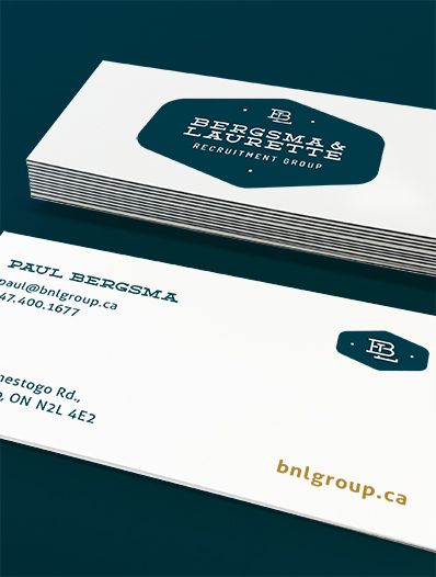white business cards on teal background